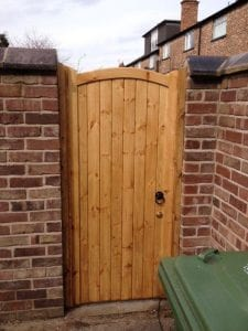 single light brown wooden gate