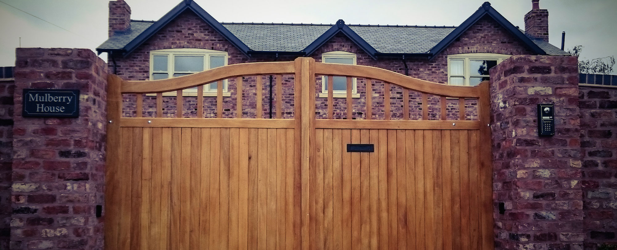 wooden gate with steel intercom