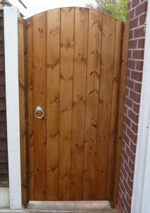 wooden side gate with top coat treatment