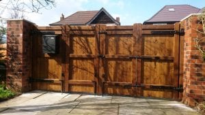 Bi-fold softwood gates with postbox