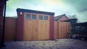 two wooden side gates and a garage gate