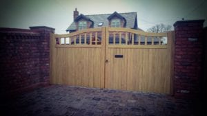oak wooden gate with a letter box