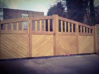 Iroko hardwood Bi-Fold Driveway Gates - Tarporley Design