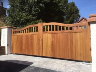 Iroko hardwood chester design driveway gates in teak finish