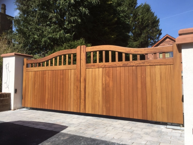 Iroko hardwood chester design driveway gates in teak finish