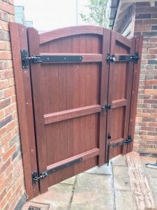 Meranti lymm style side gate with opening panel in mahogany rear view