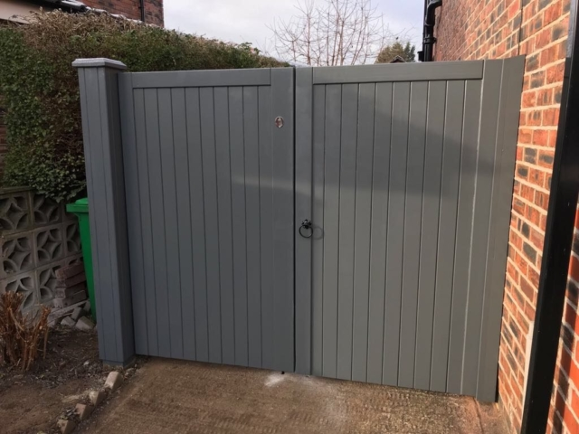 Village design drvieway gates in grey finish