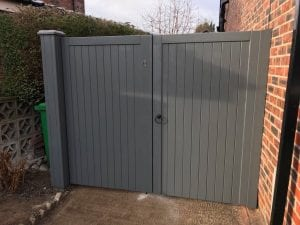 Village design driveway gates in grey finish