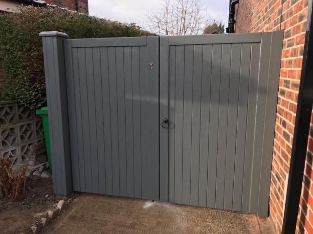 Village design drvieway gates in grey finish