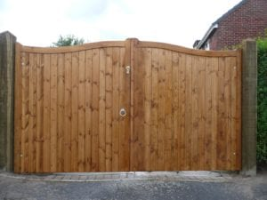 double wooden gate on driveway
