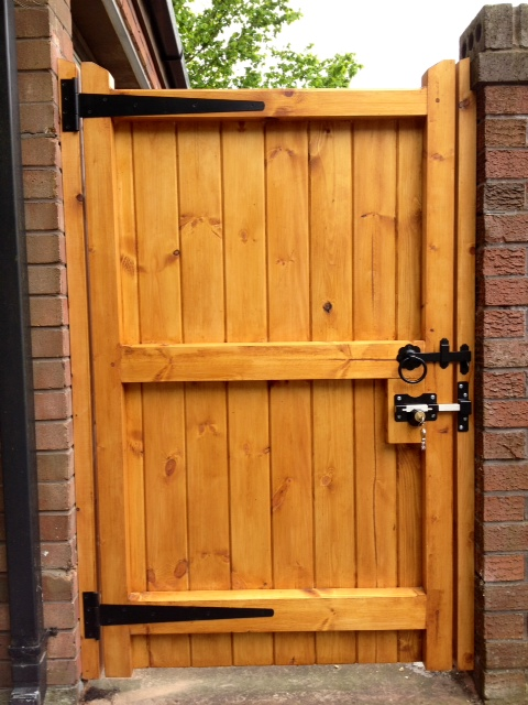 wooden gate treated with latch