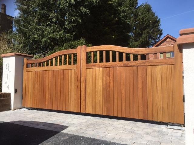 Iroko Chester design driveway gates in light oak finish