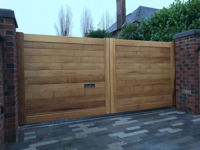 Iroko double gates in knutsford design in light oak finish
