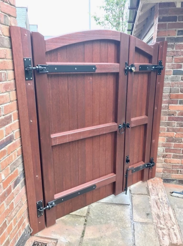 Meranti lymm style gate with panel in mahogany rear view