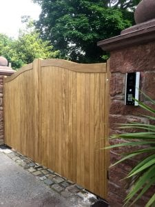 Meranti swan neck driveway gates in teak finish