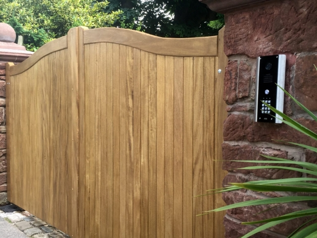 Meranti swan neck driveway gates in teak finish