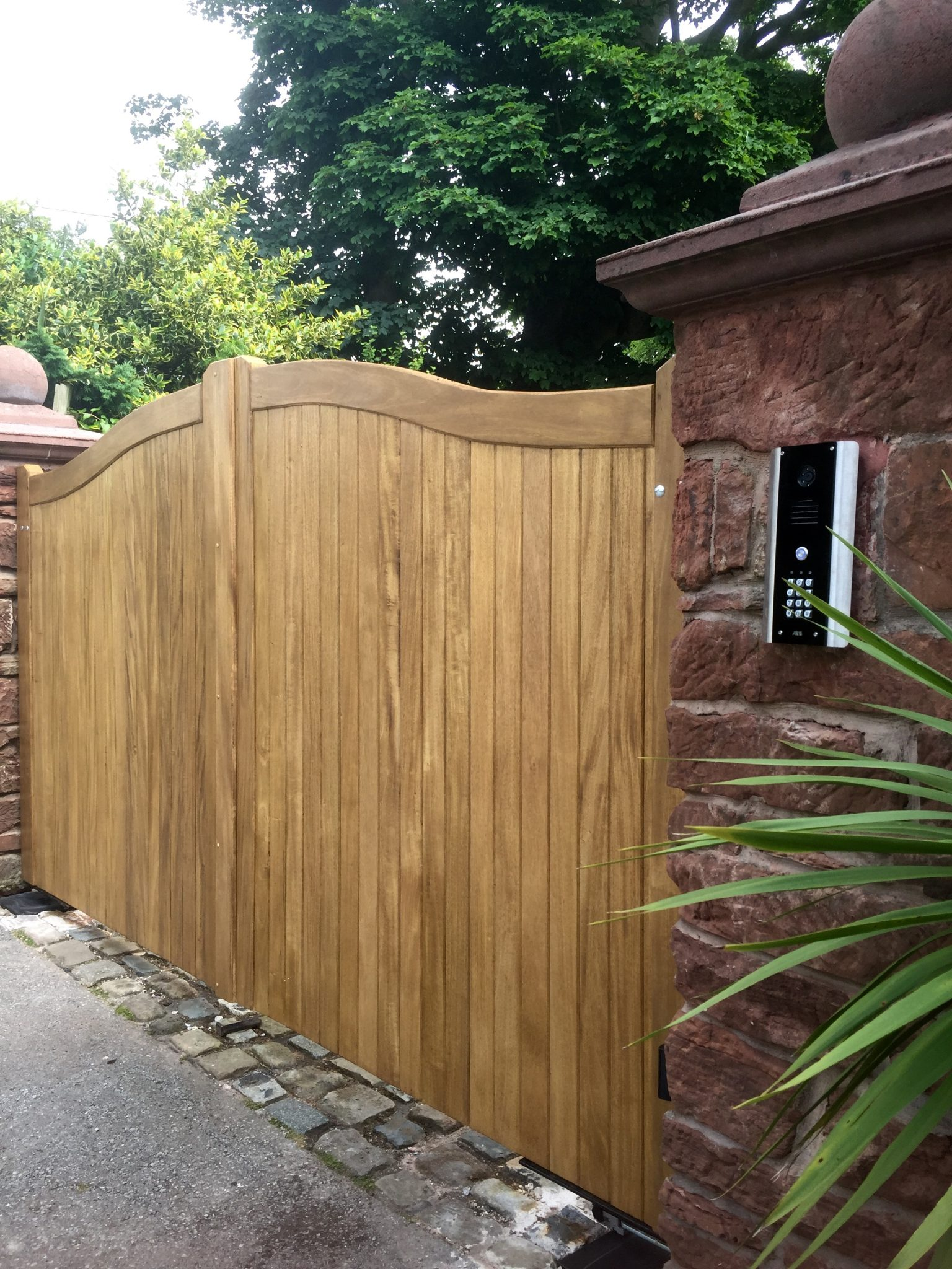 Idigbo swan neck driveway gates in mid oak finish