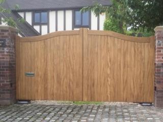 Idigbo Hardwood Electric Gates in Swan Neck Design