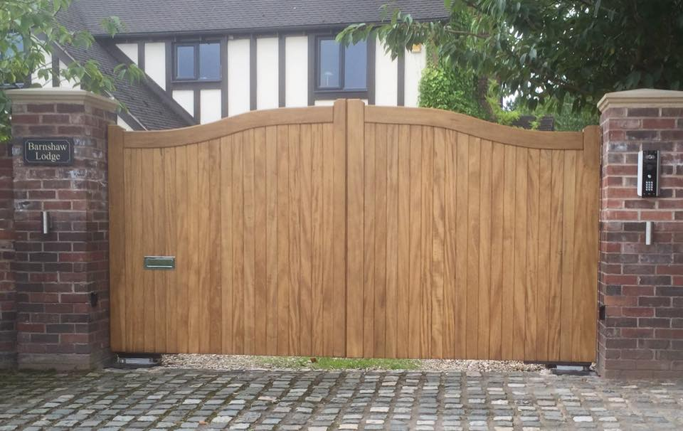 Idigbo Hardwood Electric Gates in Swan Neck Design